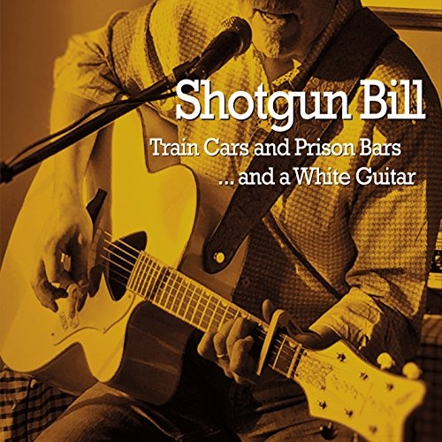 Train Cars and Prison Bars and a White Guitar